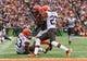 Nov 17, 2013; Cincinnati, OH, USA; Cincinnati Bengals tight end Jermaine Gresham (84) scores a touchdown as Cleveland Browns cornerback Joe Haden (23) tries to defend during the game at Paul Brown Stadium. Cincinnati won 41-20.  Mandatory Credit: Kevin Jairaj-USA TODAY Sports
