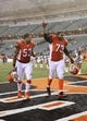 Nov 17, 2013; Cincinnati, OH, USA; Cincinnati Bengals tackle Anthony Collins (73) and linebacker Michael Boley (53) celebrate the victory after the game against the Cleveland Browns at Paul Brown Stadium. Cincinnati won 41-20.  Mandatory Credit: Kevin Jairaj-USA TODAY Sports