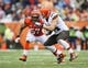 Nov 17, 2013; Cincinnati, OH, USA; Cincinnati Bengals middle linebacker Vincent Rey (57) tackles Cleveland Browns tight end Jordan Cameron (84) during the game at Paul Brown Stadium. Cincinnati won 41-20.  Mandatory Credit: Kevin Jairaj-USA TODAY Sports