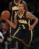 Nov 20, 2013; New York, NY, USA; Indiana Pacers point guard George Hill (3) controls the ball against the New York Knicks during the third quarter at Madison Square Garden. The Pacers defeated the Knicks 103-96 in overtime. Mandatory Credit: Brad Penner-USA TODAY Sports