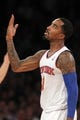 Nov 20, 2013; New York, NY, USA; New York Knicks shooting guard J.R. Smith (8) reacts to making a three-point basket against the Indiana Pacers during the third quarter at Madison Square Garden. The Pacers defeated the Knicks 103-96 in overtime. Mandatory Credit: Brad Penner-USA TODAY Sports