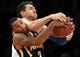 Nov 20, 2013; New York, NY, USA; Indiana Pacers point guard George Hill (3) and New York Knicks power forward Andrea Bargnani (77) fight for a rebound during the third quarter at Madison Square Garden. The Pacers defeated the Knicks 103-96 in overtime. Mandatory Credit: Brad Penner-USA TODAY Sports