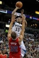 Nov 20, 2013; Minneapolis, MN, USA; Minnesota Timberwolves forward Dante Cunningham (33) shoots over Los Angeles Clippers forward Blake Griffin (32) during the third quarter at Target Center. The Clippers defeated the Timberwolves 102-98. Mandatory Credit: Brace Hemmelgarn-USA TODAY Sports