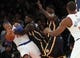 Nov 20, 2013; New York, NY, USA; New York Knicks small forward Carmelo Anthony (7) is fouled by Indiana Pacers shooting guard Lance Stephenson (1) during the third quarter at Madison Square Garden. The Pacers defeated the Knicks 103-96 in overtime. Mandatory Credit: Brad Penner-USA TODAY Sports