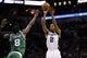 Nov 20, 2013; San Antonio, TX, USA; San Antonio Spurs forward Kawhi Leonard (2) shoots while being defended by Boston Celtics guard Jeff Green (8) during the second half at AT&T Center. The Spurs won 104-93. Mandatory Credit: Soobum Im-USA TODAY Sports