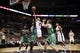 Nov 20, 2013; San Antonio, TX, USA; San Antonio Spurs guard Tony Parker (9) drives for the basket between Boston Celtics guard Jeff Green (left) and center Kelly Olynyk (right) during the second half at AT&T Center. The Spurs won 104-93. Mandatory Credit: Soobum Im-USA TODAY Sports