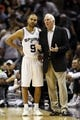 Nov 20, 2013; San Antonio, TX, USA; San Antonio Spurs head coach Gregg Popovich talks to guard Tony Parker (9) during the second half against the Boston Celtics at AT&T Center. The Spurs won 104-93. Mandatory Credit: Soobum Im-USA TODAY Sports