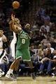 Nov 20, 2013; San Antonio, TX, USA; San Antonio Spurs forward Tim Duncan (behind) pressures Boston Celtics guard Jeff Green (8) during the second half at AT&T Center. The Spurs won 104-93. Mandatory Credit: Soobum Im-USA TODAY Sports