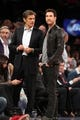 Nov 20, 2013; New York, NY, USA; Celebrity doctor Dr. Oz (left) talks to television and film actor Dylan McDermott (right) during the game between the New York Knicks and the Indiana Pacers at Madison Square Garden. The Pacers defeated the Knicks 103-96 in overtime. Mandatory Credit: Brad Penner-USA TODAY Sports