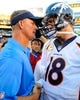 Nov 10, 2013; San Diego, CA, USA; San Diego Chargers head coach Mike McCoy (left) talks with Denver Broncos quarterback Peyton Manning (18) after a Broncos win at Qualcomm Stadium. The Broncos won 28-20. Mandatory Credit: Christopher Hanewinckel-USA TODAY Sports