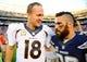 Nov 10, 2013; San Diego, CA, USA; Denver Broncos quarterback Peyton Manning (18) talks with San Diego Chargers safety Eric Weddle (32) at Qualcomm Stadium. The Broncos won 28-20. Mandatory Credit: Christopher Hanewinckel-USA TODAY Sports