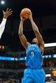 Nov 1, 2013; Minneapolis, MN, USA; Oklahoma City Thunder power forward Serge Ibaka (9) rebounds against the Minnesota Timberwolves in the second quarter at Target Center. Timberwolves won 100-81. Mandatory Credit: Greg Smith-USA TODAY Sports