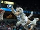 Nov 1, 2013; Minneapolis, MN, USA; Minnesota Timberwolves mascot Crunch dunks the ball during a break against the Oklahoma City Thunder in the fourth quarter at Target Center. Timberwolves won 100-81. Mandatory Credit: Greg Smith-USA TODAY Sports