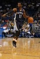 Oct 18, 2013; Orlando, FL, USA; Memphis Grizzlies point guard Mike Conley (11) dribbles the ball against the Orlando Magic during the first half at Amway Center. Mandatory Credit: Kim Klement-USA TODAY Sports