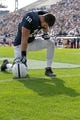 Nov 2, 2013; University Park, PA, USA; Penn State Nittany Lions tight end Jesse James (18) kneels in the end zone prior to the game against the Illinois Fighting Illini at Beaver Stadium. Penn State defeated Illinois 24-17. Mandatory Credit: Matthew O'Haren-USA TODAY Sports