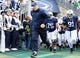 Nov 16, 2013; University Park, PA, USA; Penn State Nittany Lions head coach Bill O'Brien leads his team on the field prior to the game against the Purdue Boilermakers at Beaver Stadium.  Penn State defeated Purdue  45-21.  Mandatory Credit: Rich Barnes-USA TODAY Sports