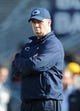Nov 16, 2013; University Park, PA, USA; Penn State Nittany Lions head coach Bill O'Brien blows a bubble prior to the game against the Purdue Boilermakers at Beaver Stadium.  Penn State defeated Purdue  45-21.  Mandatory Credit: Rich Barnes-USA TODAY Sports