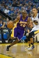 Oct 30, 2013; Oakland, CA, USA; Los Angeles Lakers shooting guard Jodie Meeks (20) drives in against Golden State Warriors point guard Stephen Curry (30) during the first quarter at Oracle Arena. Mandatory Credit: Kelley L Cox-USA TODAY Sports