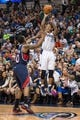 Oct 30, 2013; Dallas, TX, USA; Dallas Mavericks shooting guard Monta Ellis (11) shoots the ball over Atlanta Hawks point guard Jeff Teague (0) during the game at American Airlines Center. The Mavericks defeated the Hawks 118-109. Mandatory Credit: Jerome Miron-USA TODAY Sports