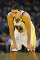 Oct 30, 2013; Oakland, CA, USA; Golden State Warriors shooting guard Klay Thompson (11) between plays against the Los Angeles Lakers during the third quarter at Oracle Arena. The Golden State Warriors defeated the Los Angeles Lakers 125-94. Mandatory Credit: Kelley L Cox-USA TODAY Sports
