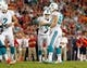 Nov 11, 2013; Tampa, FL, USA; Miami Dolphins kicker Caleb Sturgis (9) is congratulated by outside linebacker Jason Trusnik (93) after they kicked a field goal against the Tampa Bay Buccaneers during the second half at Raymond James Stadium. Mandatory Credit: Kim Klement-USA TODAY Sports
