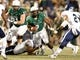 Nov 21, 2013; Birmingham, AL, USA;  UAB Blazers running back Darrin Reaves (5) is grabbed by Rice Owls linebacker Michael Kutzler (42) at Legion Field. Mandatory Credit: Marvin Gentry-USA TODAY Sports