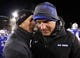 Nov 21, 2013; Colorado Springs, CO, USA; UNLV Rebels head coach Bobby Hauck (left) talks with Air Force Falcons head coach Troy Calhoun (right) after the end of the game at Falcon Stadium. The Rebels won 41-21. Mandatory Credit: Isaiah J. Downing-USA TODAY Sports