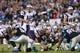 Nov 18, 2013; Charlotte, NC, USA; New England Patriots quarterback Tom Brady (12) calls signals in the third quarter. The Panthers defeated the Patriots 24-20 at Bank of America Stadium. Mandatory Credit: Bob Donnan-USA TODAY Sports