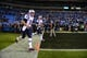 Nov 18, 2013; Charlotte, NC, USA; New England Patriots quarterbacks Tom Brady (12) and Ryan Mallett (15) run on to the field at Bank of America Stadium. Mandatory Credit: Bob Donnan-USA TODAY Sports