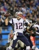 Nov 18, 2013; Charlotte, NC, USA; New England Patriots quarterback Tom Brady (12) looks to pass in the fourth quarter. The Panthers defeated the Patriots 24-20 at Bank of America Stadium. Mandatory Credit: Bob Donnan-USA TODAY Sports