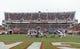 Nov 16, 2013; Blacksburg, VA, USA; Virginia Tech Hokies punter A.J. Hughes (27)  punts the ball in the second quarter at Lane Stadium. Mandatory Credit: Bob Donnan-USA TODAY Sports