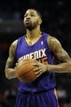 Nov 22, 2013; Charlotte, NC, USA; Phoenix Suns forward Marcus Morris (15) looks to take a foul shot during the first half of the game against the Charlotte Bobcats at Time Warner Cable Arena. Mandatory Credit: Sam Sharpe-USA TODAY Sports