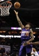 Nov 22, 2013; Charlotte, NC, USA; Phoenix Suns guard Archie Goodwin (20) drives to the basket and scores during the first half of the game against the Charlotte Bobcats at Time Warner Cable Arena. Mandatory Credit: Sam Sharpe-USA TODAY Sports