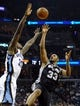 Nov 22, 2013; Memphis, TN, USA; San Antonio Spurs power forward Boris Diaw (33) shoots the ball over Memphis Grizzlies power forward Ed Davis (32) during the second quarter at FedExForum. Mandatory Credit: Justin Ford-USA TODAY Sports
