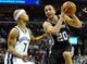 Nov 22, 2013; Memphis, TN, USA; San Antonio Spurs shooting guard Manu Ginobili (20) drives to the basket against Memphis Grizzlies point guard Jerryd Bayless (7) during the second quarter at FedExForum. Mandatory Credit: Justin Ford-USA TODAY Sports
