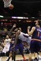 Nov 22, 2013; Charlotte, NC, USA; Charlotte Bobcats forward Michael Kidd-Gilchrist (14) drives to the basket through Phoenix Suns forward center Channing Frye (8) and guard Goran Dragic (1) during the second half of the game at Time Warner Cable Arena. Suns win 98-91. Mandatory Credit: Sam Sharpe-USA TODAY Sports