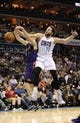 Nov 22, 2013; Charlotte, NC, USA; Charlotte Bobcats forward Josh McRoberts (11) and Phoenix Suns guard Goran Dragic (1) fight for a rebound during the second half of the game at Time Warner Cable Arena. Suns win 98-91. Mandatory Credit: Sam Sharpe-USA TODAY Sports
