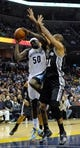 Nov 22, 2013; Memphis, TN, USA; Memphis Grizzlies power forward Zach Randolph (50) lays the ball up over San Antonio Spurs power forward Tim Duncan (21) during the third quarter at FedExForum. Mandatory Credit: Justin Ford-USA TODAY Sports