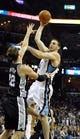 Nov 22, 2013; Memphis, TN, USA; Memphis Grizzlies center Kosta Koufos (41) shoots the ball over San Antonio Spurs center Tiago Splitter (22) during the fourth quarter at FedExForum. San Antonio Spurs beat the Memphis Grizzlies 102-86. Mandatory Credit: Justin Ford-USA TODAY Sports