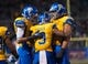 Nov 22, 2013; San Jose, CA, USA; San Jose State Spartans running back Thomas Tucker (3) and wide receiver Chandler Jones (89) and center David Peterson (51) celebrate after scoring against the Navy Midshipmen during the second quarter at Spartan Stadium. Mandatory Credit: Ed Szczepanski-USA TODAY Sports