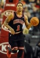 Nov 22, 2013; Portland, OR, USA; Chicago Bulls point guard Derrick Rose (1) brings the ball up the court during the third quarter of the game at the Moda Center. The Blazers won the game 98-95. Mandatory Credit: Steve Dykes-USA TODAY Sports