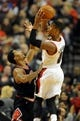 Nov 22, 2013; Portland, OR, USA; Portland Trail Blazers point guard Damian Lillard (0) looks to pass the ball as he is defended by Chicago Bulls point guard Derrick Rose (1) during the third quarter of the game at the Moda Center. The Blazers won the game 98-95. Mandatory Credit: Steve Dykes-USA TODAY Sports