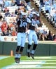 Nov 23, 2013; Chapel Hill, NC, USA; North Carolina Tar Heels receiver Quinshad Davis (14) celebrates his first half touchdown against the Old Dominion Monarchs with teammate Kendrick Singleton (81) at Kenan Memorial Stadium. Mandatory Credit: Rob Kinnan-USA TODAY Sports