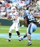 Nov 23, 2013; Chapel Hill, NC, USA; Old Dominion Monarchs quarterback Taylor Heinicke (14) drops back to pass as North Carolina Tar Heels defensive end Kareem Martin (95) pressures during the first half at Kenan Memorial Stadium. Mandatory Credit: Rob Kinnan-USA TODAY Sports