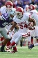 Nov 23, 2013; Manhattan, KS, USA; Oklahoma Sooners running back Brennan Clay (24) runs the ball against the Kansas State Wildcats during the first half at Bill Snyder Family Stadium. Mandatory Credit: Jasen Vinlove-USA TODAY Sports