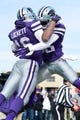 Nov 23, 2013; Manhattan, KS, USA; Kansas State Wildcats wide receiver Tyler Lockett (16) is congratulated after scoring a touchdown by teammate Tramaine Thompson (86) against the Oklahoma Sooners during the first half at Bill Snyder Family Stadium. Mandatory Credit: Jasen Vinlove-USA TODAY Sports