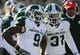 Nov 23, 2013; Evanston, IL, USA; Michigan State Spartans safety Isaiah Lewis (9) reacts to being ejected from the game for a personal foul against Northwestern Wildcats quarterback Kain Colter (2) during the first quarter at Ryan Field. Mandatory Credit: Reid Compton-USA TODAY Sports