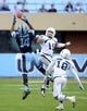 Nov 23, 2013; Chapel Hill, NC, USA; North Carolina Tar Heels receiver Quinshad Davis (14) makes a leaping catch behind Old Dominion Monarchs cornerback Aaron Evans (15) during the first half at Kenan Memorial Stadium. Mandatory Credit: Rob Kinnan-USA TODAY Sports