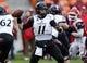 Nov 23, 2013; Houston, TX, USA; Cincinnati Bearcats quarterback Brendon Kay (11) attempts a pass during the second quarter against the Houston Cougars at BBVA Compass Stadium. Mandatory Credit: Troy Taormina-USA TODAY Sports
