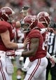 Nov 23, 2013; Tuscaloosa, AL, USA;  Alabama Crimson Tide running back Derrick Henry (27) celebrates his touchdown with offensive linesman Ryan Kelly (70) against the Chattanooga Mocs during the second quarter at Bryant-Denny Stadium. Mandatory Credit: John David Mercer-USA TODAY Sports